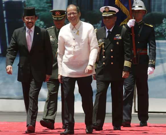 Visiting Sultan Hassanal Bolkiah of Brunei, is escorted by Philippine President Benigno Aquino III, on the grounds of Malacanang Palace, in Manila, Philippines.