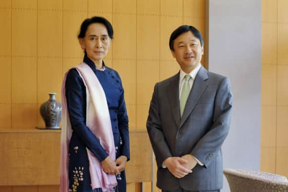 Nobel laureate and Myanmar opposition leader Aung San Suu Kyi, left, and Japanese Crown Prince Naruhito pose for photographers during their meeting at the latter`s residence Togu Palace in Tokyo.