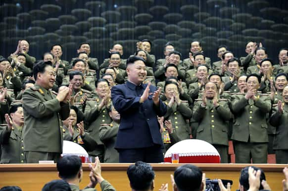 North Korean leader Kim Jong Un applauds as he visits an athletics contest held by Kim Il Sung University of Politics and Kim Il Sung Military University, at a stadium in North Korea.