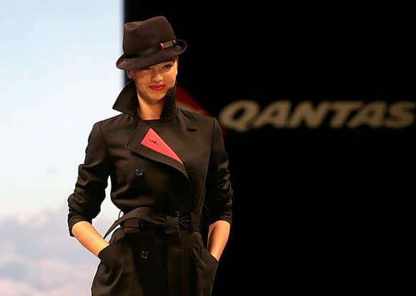Model Miranda Kerr struts down the runway modeling the new look Qantas Airways uniform in Sydney, Australia.