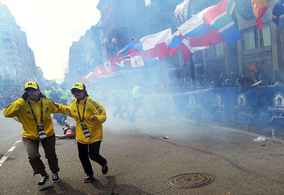 People react to an explosion at the 2013 Boston Marathon in Boston.
