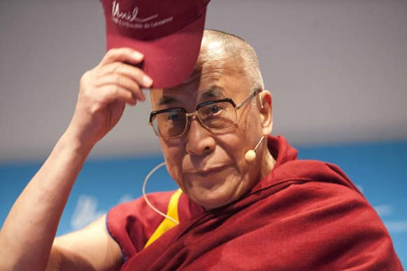 Tibetan spiritual leader Dalai Lama puts a cap on, during an event at the UNIL, University of Lausanne, Switzerland. The Dalai Lama pays a four day visit to Switzerland.