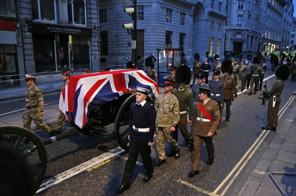British forces` officers escort a Union Jack-draped coffin on a gun carriage drawn by the King`s Troop Royal Artillery during a rehearsal for the upcoming funeral of former British Prime Minister Margaret Thatcher in central London.