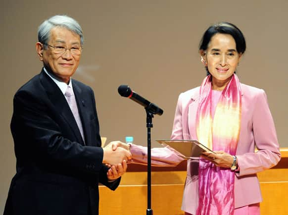 Nobel laureate and Myanmar opposition leader Aung San Suu Kyi, receives a title of honorary fellow from President of Kyoto University Hiroshi Matsumoto at Kyoto University where she studied nearly three decades ago, in Kyoto.