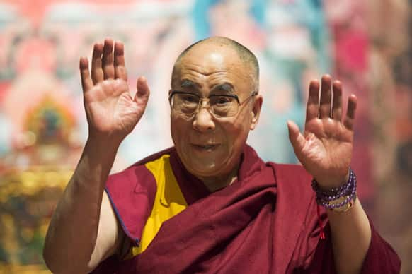 Tibetan spiritual leader Dalai Lama gestures during a spiritual event at the Forum Arena in Fribourg, western Switzerland. The Dalai Lama pays a four day visit to Switzerland.