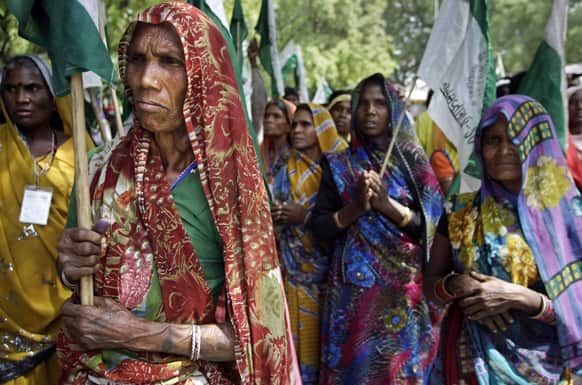 Members of India`s rural communities, including the landless, poor farmers and the tribal community, participate in a protest near the Indian parliament in New Delhi.
