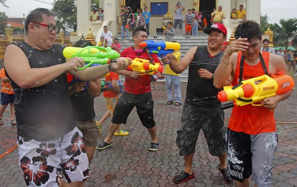 People shoot each other with water guns as they celebrate the Songkran festival, the Thai traditional New Year, also known as the water festival in Petaling Jaya, near Kuala Lumpur, Malaysia.