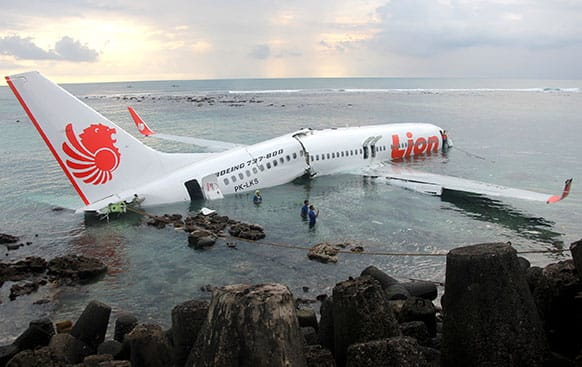 In this photo released by Indonesian Police, the wreckage of a crashed Lion Air plane sits on the water near the airport in Bali, Indonesia.