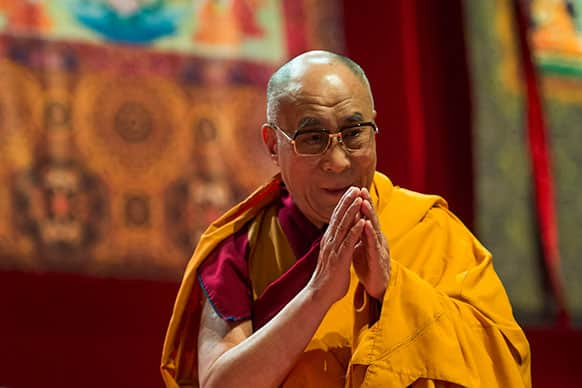 Tibetan spiritual leader Dalai Lama gestures during a spiritual event at the Forum Arena in Fribourg, western Switzerland.