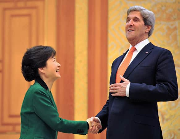 South Korean President Park Geun-hye and US Secretary of State John Kerry shake hands before their meeting at the presidential Blue House in Seoul.