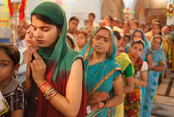 Indian devotees stand in queue to offer prayers at a Hindu temple on the second day of `Navratri` or the nine nights festival in Allahabad.