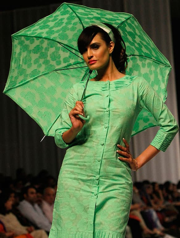 A Pakistani model presents a creation by Kayseria, on the second and last day of Fashion Pakistan Week.