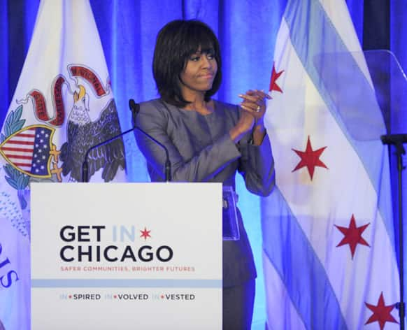 First lady Michelle Obama says goodbye to the crowd after speaking during a luncheon at the Chicago Hilton in Chicago.