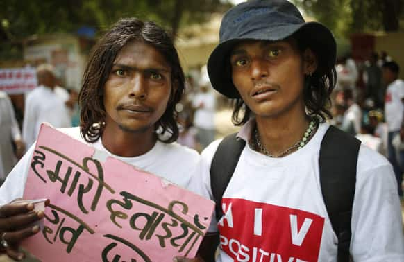 People affected with HIV participate in a protest rally to oppose a free trade agreement between India and European Union, in New Delhi.