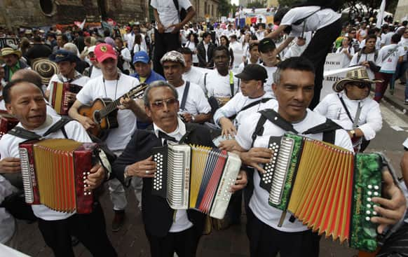 Musicians play during a March for Peace in Bogota, Colombia.