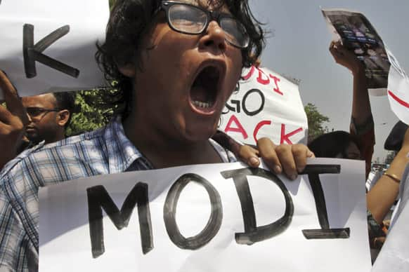 Activists of Naxalite group shout slogans as they protest the visit of Gujarat state Chief Minister Narendra Modi outside a hotel in Kolkata.