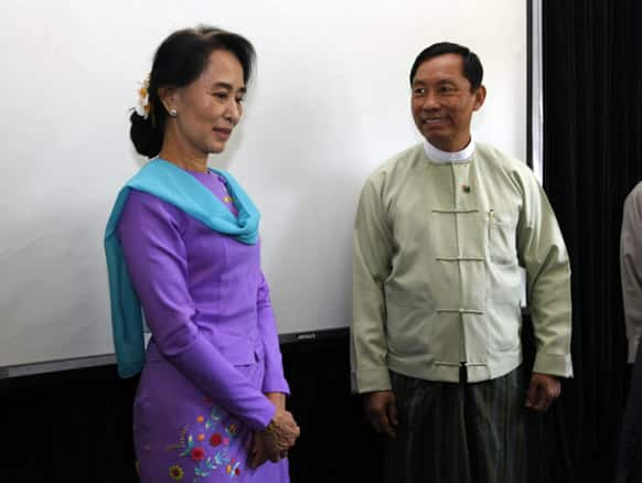 Myanmar Lower House Speaker Thura Shwe Mann and opposition leader Aung San Suu Kyi attend a meeting for the renovation of Yangon General Hospital, which is more than 110 year old, in Yangon, Myanmar.