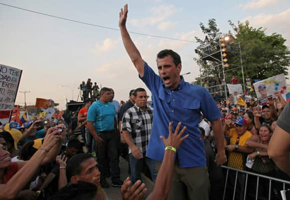 Opposition presidential candidate Henrique Capriles greets supporters during a campaign rally in Puerto La Cruz, Venezuela. Capriles is running against ruling party candidate Nicolas Maduro in next weekend`s presidential election.