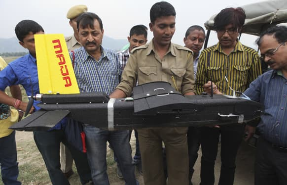 Forest officials look at an unmanned aircraft or drone before it`s first flight at the Kaziranga National Park at Kaziranga in Assam state.