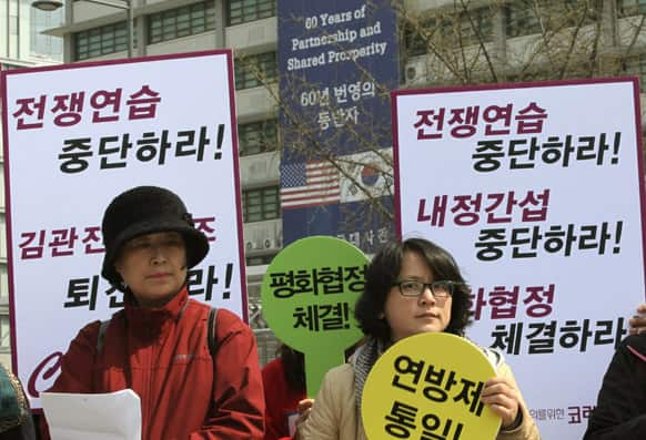 South Korean housewives stage a press conference denouncing the annual joint military exercise known as Foal Eagle, between South Korea and the United States, near the U.S. Embassy in Seoul, South Korea.