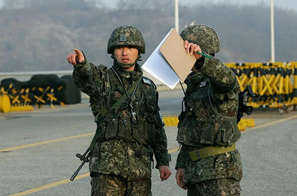 South Korean army soldiers talk near a barricade set up on Unification Bridge near the border village of Panmunjom, which has separated the two Koreas since the Korean War, in Paju, north of Seoul, South Korea.