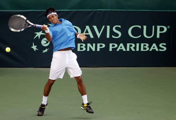 Somdev Devvarman returns a shot to Indonesia`s David Agung Susanto during their Group I Asia-Oceania relegation playoff tennis reverse single match at the Davis Cup between India and Indonesia in Bangalore.