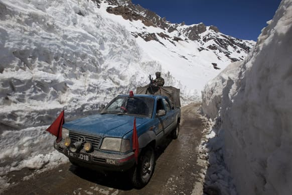 An Indian army vehicle passes walls of snow near Zojila Pass, about 110 kilometers (68 miles) north of Srinagar. The Srinagar-Leh National Highway connecting Ladakh to the Kashmir Valley was re-opened to traffic Saturday after remaining closed for nearly six months.