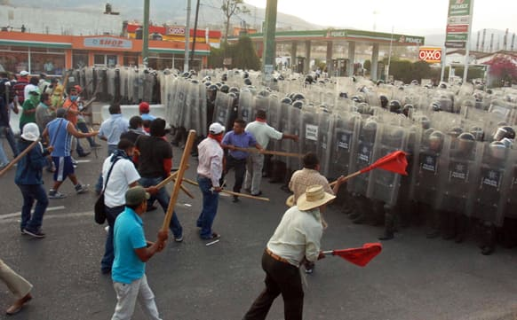 Public school teachers clash with Mexico`s Federal Police after they blocked a highway that connects Mexico City with Acapulco in Chilpancingo, Mexico.