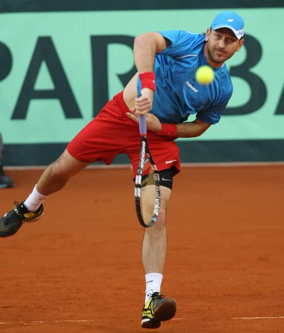 Jan Hajek of Czech Republic returns to Kazakhstan`s Mikhail Kukushkin during a Davis Cup quaterfinal match between Kazakhstan and Czech Republic in Astana, Kazakhstan.