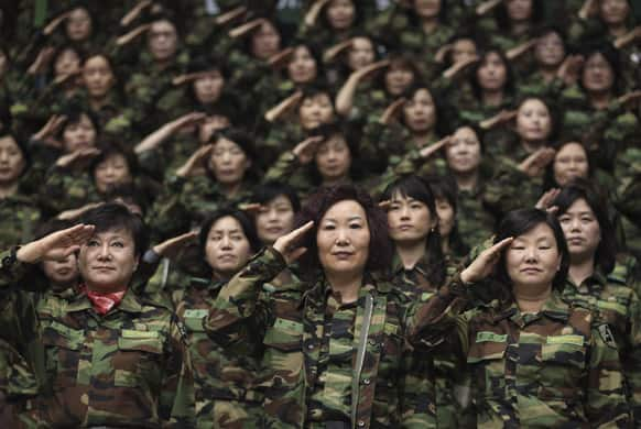 South Korean army reservists salute during their Foundation Day ceremony at a gymnasium in Seoul, South Korea. About 1,000 reservists gathered here to denounce North Korean for their escalating threat for war.