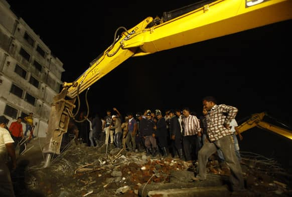 Rescue workers look for trapped people after a residential building collapsed in Thane, Mumbai.