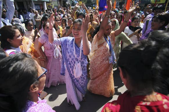 Hindu devotees chant religious slogans during a chariot festival procession of Lord Jagannath in Jammu.