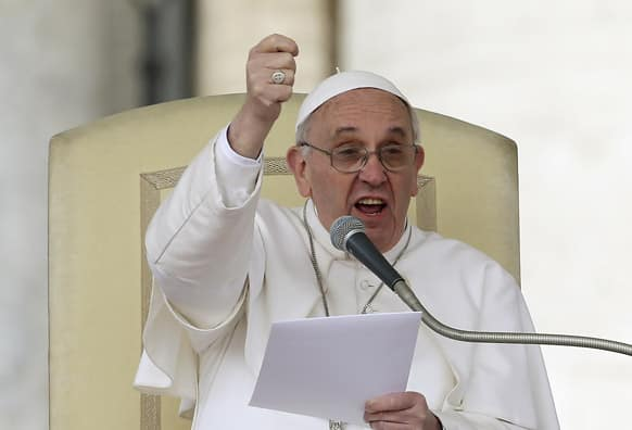 Pope Francis gestures as he speaks during his weekly general audience in St. Peter square at the Vatican.