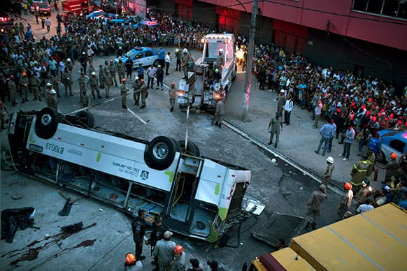 A bus is seen upside down after falling from a viaduct into Avenida Brasil, the largest avenue in Rio de Janeiro, Brazil.
