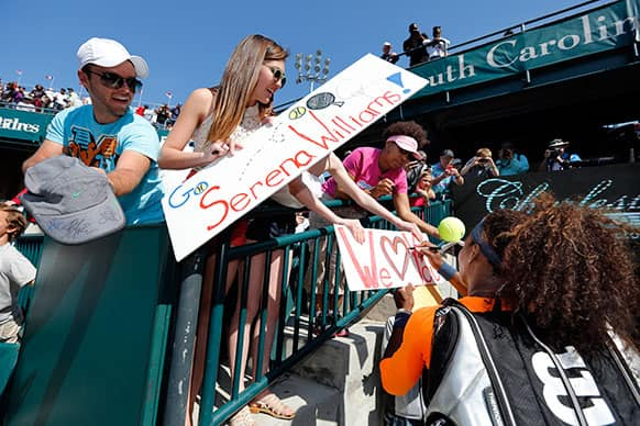 Serena Williams signs autographs after her match against Camila Giorgi, of Italy, at the Family Circle Cup tennis tournament in Charleston, S.C.