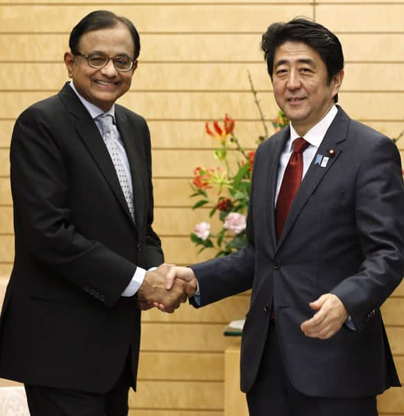 India`s Finance Minister Palaniappan Chidambaram poses with Japan`s Prime Minister Shinzo Abe during his courtesy call at Abe`s official residence in Tokyo. Chidambaram arrived in Japan Monday for a three-day visit.