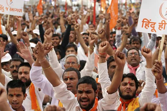 Hindus raise their hands as they attend Vishwa Hindu Parishad(VHP) or World Hindu Council`s meeting in Ahmedabad.