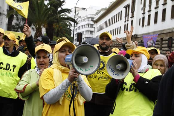 Moroccan women union activists chant slogans through loud speakers bearing the name of their CDT union in Arabic.