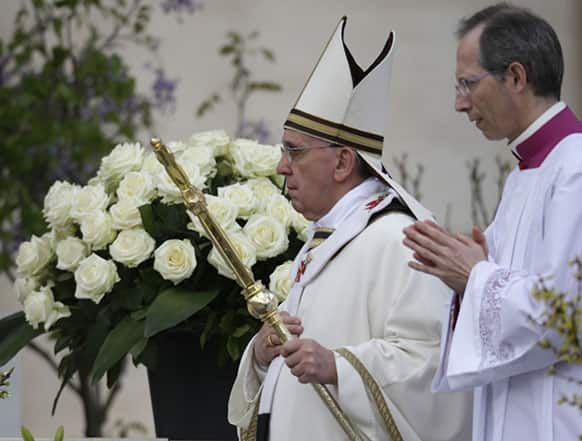 Pope Francis arrives in St. Peter`s square at the Vatican on the occasion of the celebration of the Easter mass.