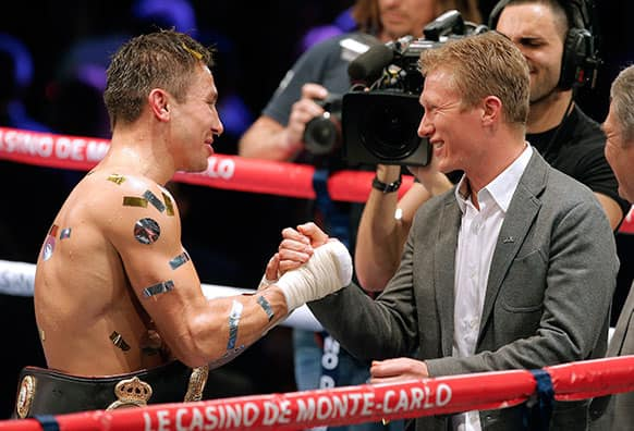 Former Kazakhstani professional road bicycle racer and current general manager of UCI, Alexander Vinokourov, right, congratulates compatriot Gennady Golovkin after his victory against Nobuhiro Ishida of Japan for the WBA middleweight world title, in Monaco.