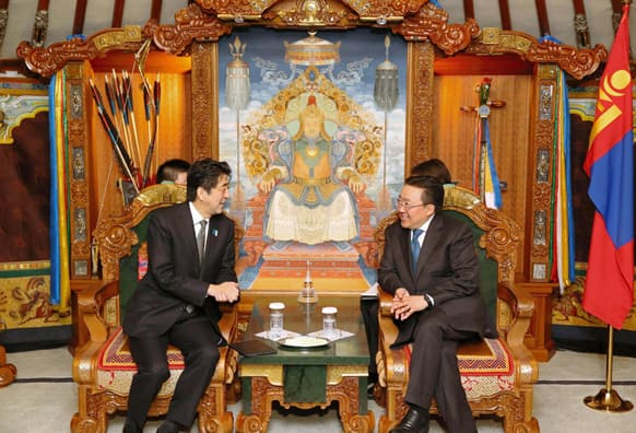 Japanese Prime Minister Shinzo Abe, left, meets with Mongolian President Tsakhia Elbegdorj on the first day of his two-day visit to Ulan Bator, Mongolia.