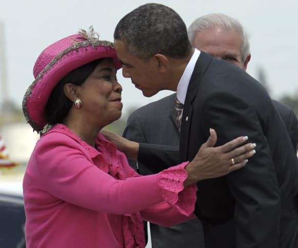 President Barack Obama is greeted by Rep. Frederica Wilson, D-Fla., after walking down the steps of Air Force One at Miami International Airport in Miami.