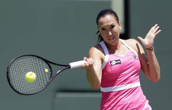 Jelena Jankovic, of Serbia, returns to Maria Sharapova, of Russia, during the semifinals of the Sony Open tennis tournament in Key Biscayne, Fla.