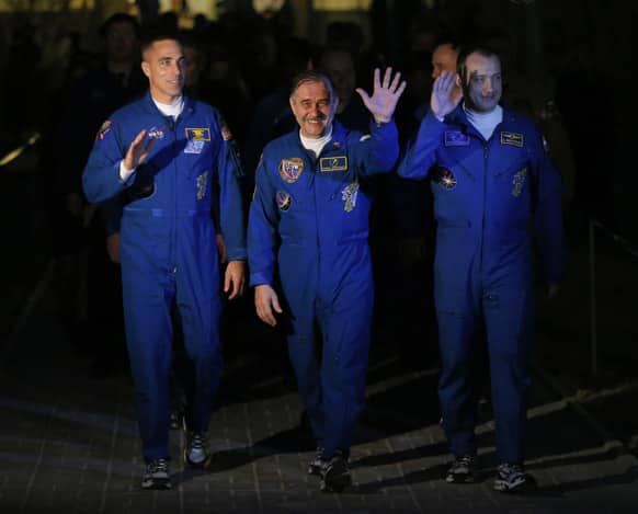 Russian Cosmonauts Alexander Misurkin and Pavel Vinogradov, US astronaut Christopher Cassidy, crew members of the mission to the International Space Station, ISS, walk to a bus from a hotel prior to the launch of their Soyuz-FG rocket at the Russian leased Baikonur cosmodrome, Kazakhstan.