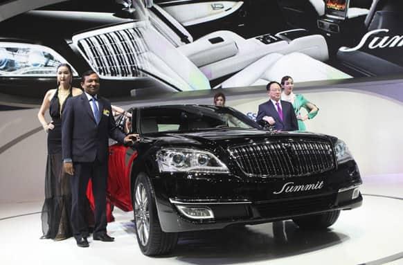 Pawan Kumar Goenka, president of Mahindra & Mahindra LMT, pose with a Ssangyong`s new model,