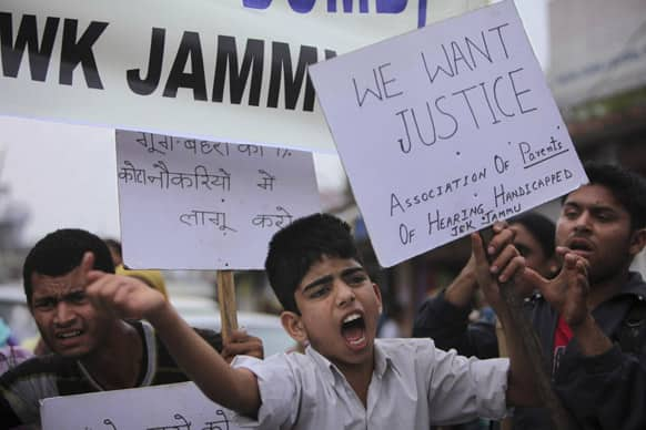 Hearing-impaired children take to a streeet in protest against the Jammu and Kashmir state government in Jammu. The protesters demanded the opening of special schools for them, allotment of slots in government jobs and other demands.