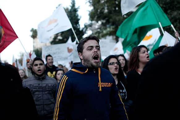 Protesters chant slogans during an anti-bailout demonstration in Nicosia, Cyprus.