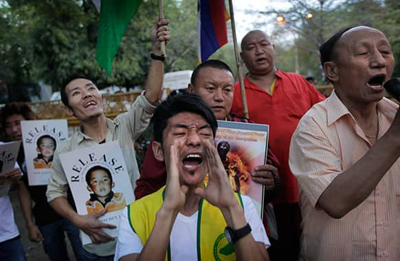 Exile Tibetans shout slogans against China demanding the release of Panchen Lama during a protest in New Delhi.