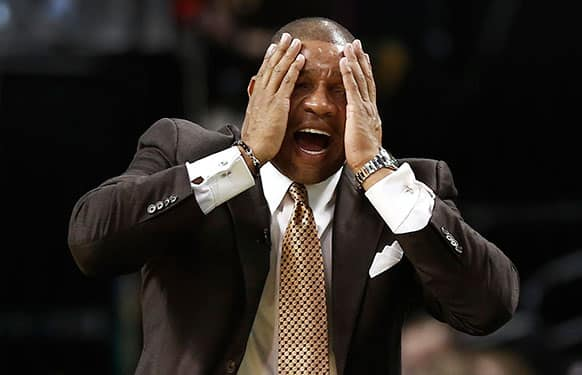 Boston Celtics head coach Doc Rivers reacts to a call against his team during the fourth quarter of their 100-85 loss to the New York Knicks in an NBA basketball game in Boston.
