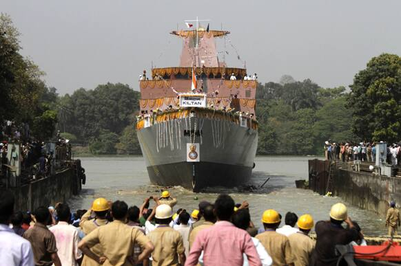 Indian cheer during the launch of Indian Navy's anti-submarine warfare corvette INS Kiltan on the Ganges river in Kolkata. The Indian built corvette is named after the Kiltan island in India's Lakshwadeep archipelago.